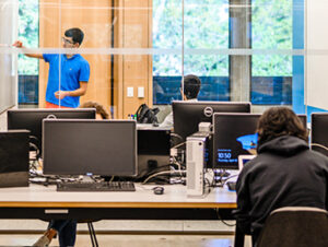 Students studying at the Moffitt Library study space